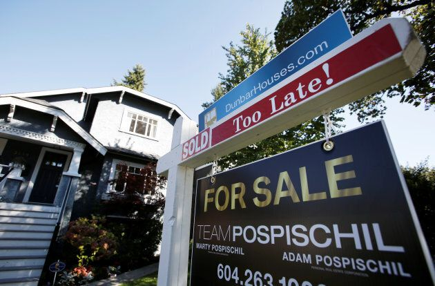A real estate for sale sign is pictured in front of a home in Vancouver, B.C., on Sept. 22, 2016.