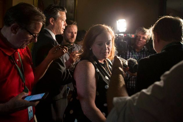 Ontario Minister of Children, Community and Social Services Lisa MacLeod turns away after scrumming with...