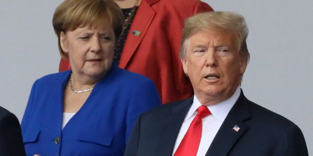 German Chancellor Angela Merkel and U.S. President Donald Trump are seen as they pose for a family photo...