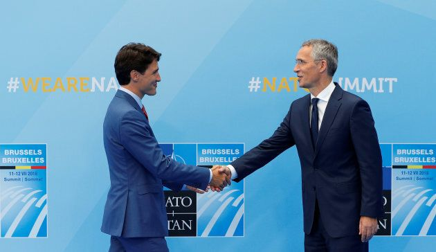 Justin Trudeau is welcomed by NATO Secretary-General Jens Stoltenberg at the start of a NATO summit at...