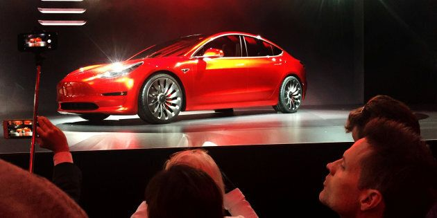 A Tesla Model 3 sedan, the automaker's first car aimed at the mass market, at its launch in Hawthorne,...