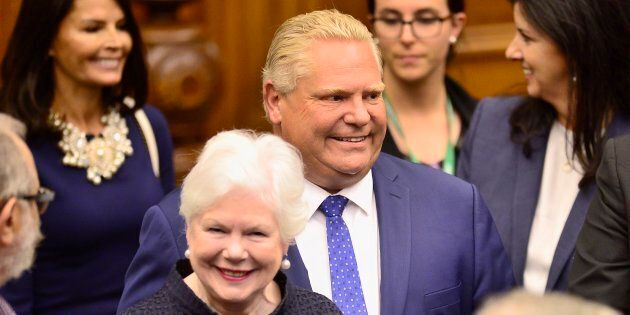 Ontario Premier Doug Ford, right, and Lt.-Gov. Elizabeth Dowdeswell arrive ahead of the speech from the...