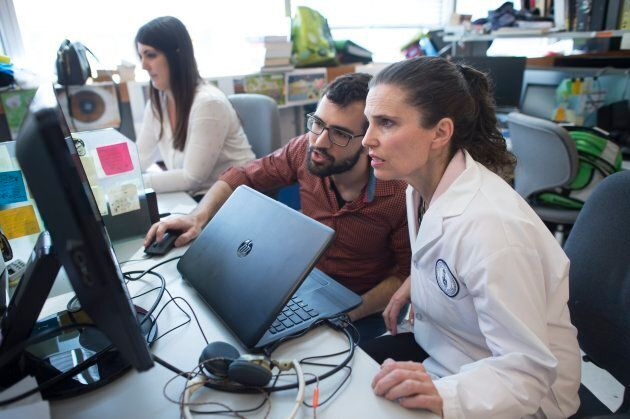 Federal Minister of Science Kirsty Duncan, right, watches a video of a blind mouse, with Nick Mitrousis,...