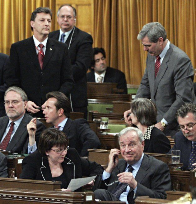 Deputy Prime Minister Anne McLellan and Prime Minister Paul Martin sit in the front row as Liberal MPs John McKay, Paul Szabo and Roy Cullen (standing left to right) vote with Conservative Party leader Stephen Harpers motion on same sex marriage legislation in the House of Commons in Ottawa on April 12, 2005.   MPs voted down the Conservative motion that would have derailed the minority Liberal government's same-sex marriage bill.