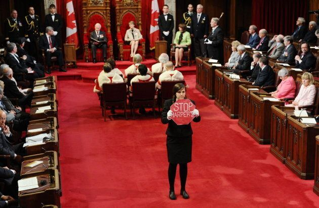 Page Brigette DePape stands in the middle of the floor of the Senate as Governor General David Johnston...