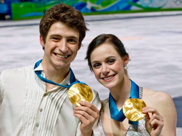 Tessa Virtue and Scott Moir pose with their gold medals during victory ceremonies on Feb. 22, 2010 at the Vancouver Olympic Winter Games.