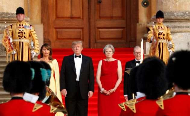 British Prime Minister Theresa May and her husband Philip stand together with U.S. President Donald Trump and first Lady Melania Trump at the entrance to Blenheim Palace, where they are attending a dinner with specially invited guests and business leaders, near Oxford, Britain on July 12, 2018.