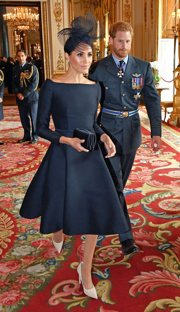 Meghan Markle wears a Dior dress at a reception to mark the centenary of the Royal Air Force on July...