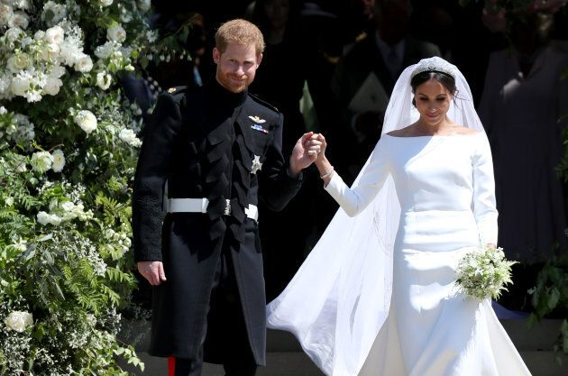 Prince Harry and Meghan Markle leave St George's Chapel in Windsor Castle after their wedding. Her wedding...