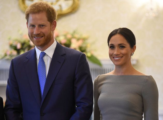 Meghan Markle wearing a Roland Mouret boatneck dress with Prince Harry on the second day of their royal...