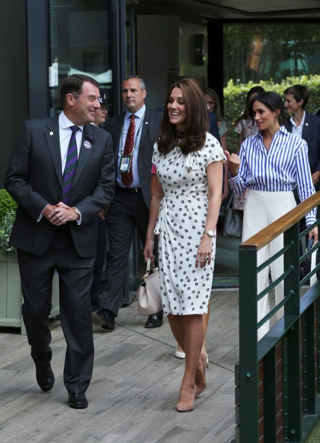 Chairman of the AELTC Philip Brook welcomes Britain's Catherine, the Duchess of Cambridge and Meghan the Duchess of Sussex, to the Wimbledon Championships at the All England Lawn Tennis and Croquet Club, Wimbledon, London, on Saturday.