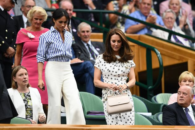 You can see more of Meghan's full outfit in this photo.