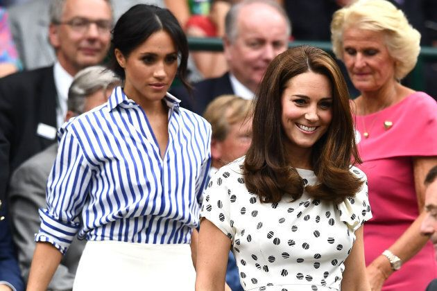 Meghan, Duchess of Sussex, and Catherine, Duchess of Cambridge, attend day twelve of the Wimbledon Lawn Tennis Championships at All England Lawn Tennis and Croquet Club on July 14, 2018 in London.  (Photo by Clive Mason/Getty Images)