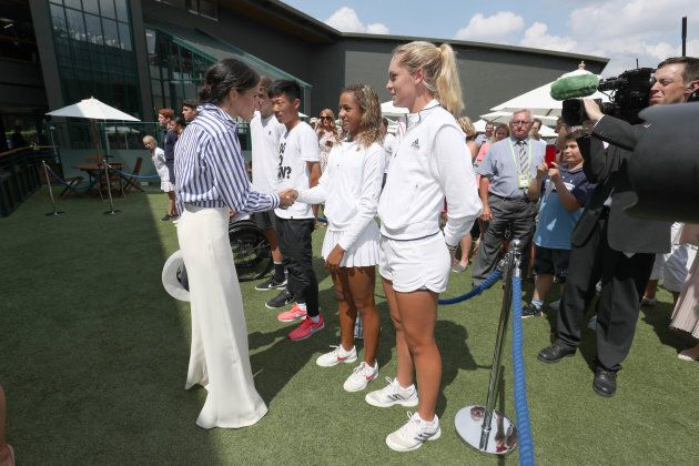 Meghan, Duchess of Sussex, shakes hands at All England Lawn Tennis and Croquet Club on July 14, 2018 in London.