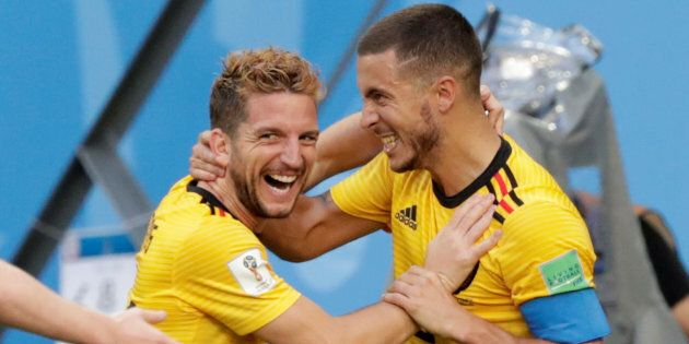 Belgium's Eden Hazard celebrates scoring their second goal against England with Dries Mertens on