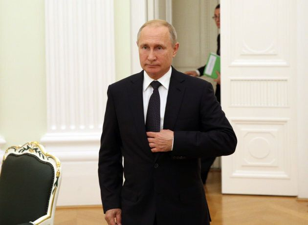 Russian President Vladimir Putin enters the hall during his meeting with President of Gabon Ali Bongo Ondimba (not pictured) at the Kremlin, in Moscow on Saturday.
