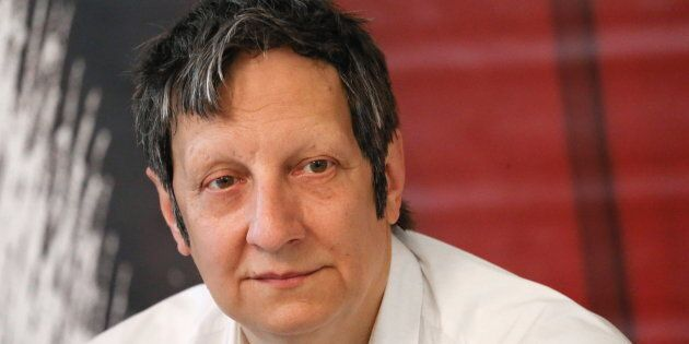 Canadian playwright, actor and director Robert Lepage looks on at a news conference at the Theatre of...