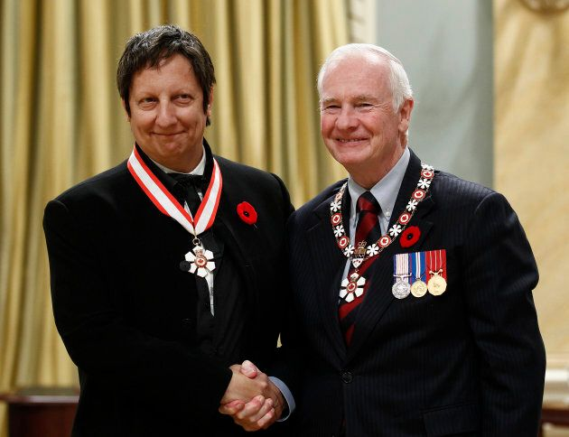 Actor, playwright and director Robert Lepage, left, shakes hands with Governor General David Johnston...
