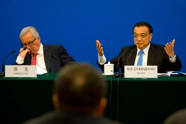 China's Premier Li Keqiang (R) gestures as he calls for action to problems raised by European businessmen,...