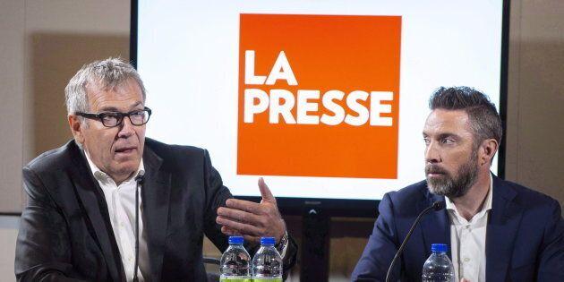 La Presse publisher Guy Crevier, left, responds to a question as president Pierre-Elliott Levasseur looks...