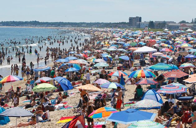 Old Orchard Beach is overloaded with visitors on a hot Fourth of