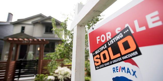 A real estate sign is pictured in Vancouver, B.C., Tues. June, 12. Canadian housing activity appears...