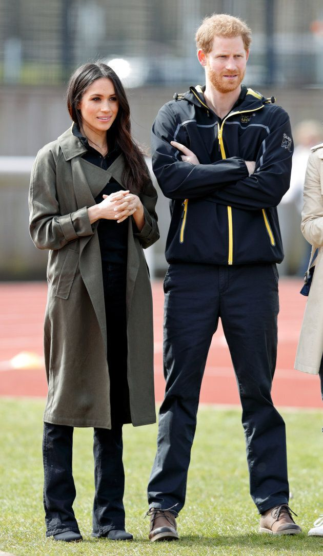 Meghan Markle, wearing an Aritzia trench coat, with Prince Harry at the UK trials for the 2018 Invictus Games on April 6.