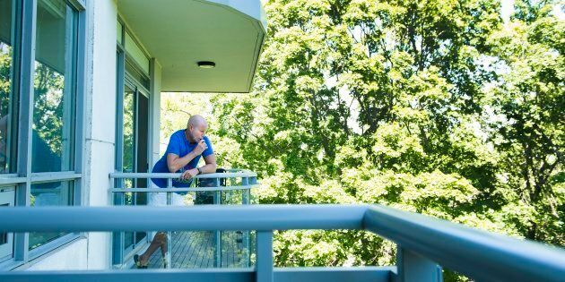 Gerald Major, 46, uses a vaporizer with medical marijuana on his back balcony at his condo in Oakville,...