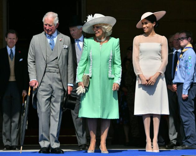 The Prince of Wales, the Duchess of Cornwall and the Duchess of Sussex at a garden party at Buckingham...