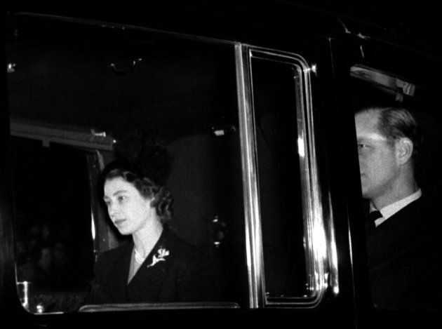 Queen Elizabeth II returns to Clarence House, London, with the Duke of Edinburgh from London Airport after the sudden death of her father, King George VI. She succeeded the King on his death a day earlier.