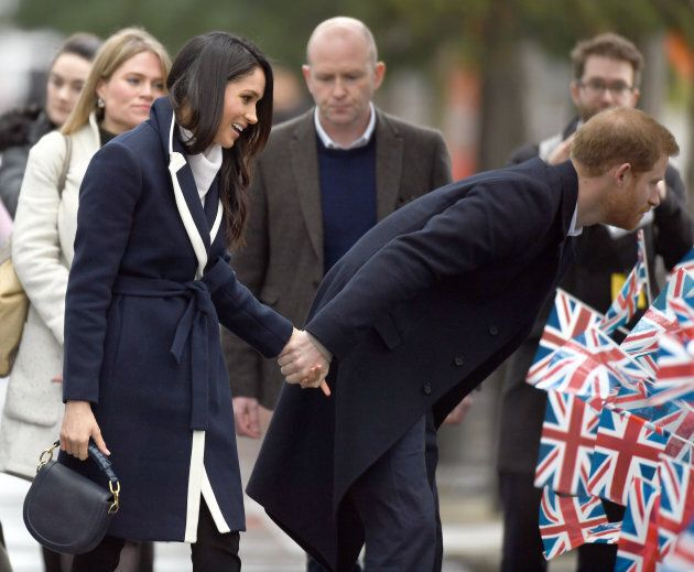 Prince Harry and Meghan Markle hold hands as they visit Millennium Point in Birmingham, England on March...