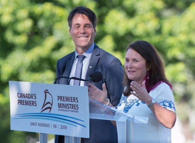 Eric Hoskins, left, head of a federal advisory council on how to implement a national pharmacare program,...