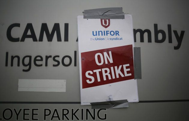 A strike poster from the auto workers union Unifor is posted at a picket line outside the General Motors Co CAMI assembly plant in Ingersoll, Ont., on Oct. 13, 2017.