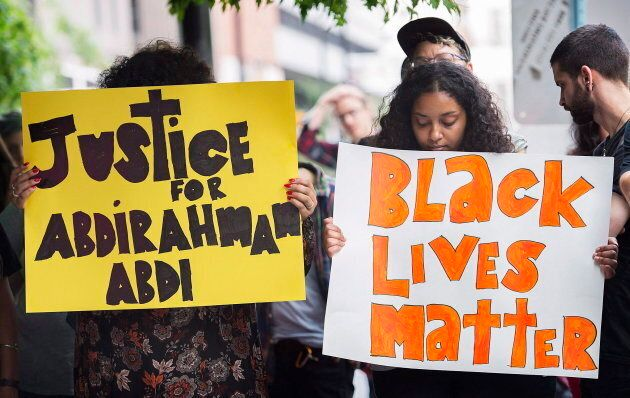 People gather in Montreal on July 28, 2016, to denounce the death of Abdirahman Abdi in