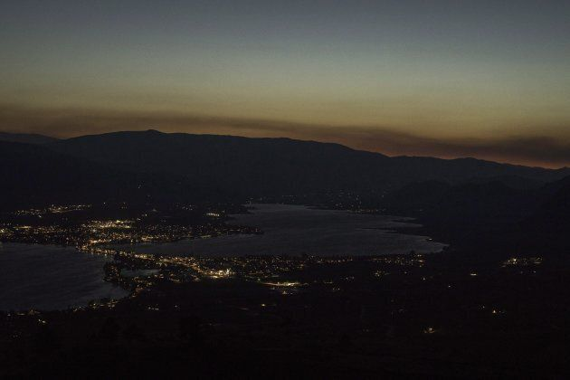 Looking high above the small town of Osoyoos B.C. in the southern Okanagan the glow of smoke and fire...