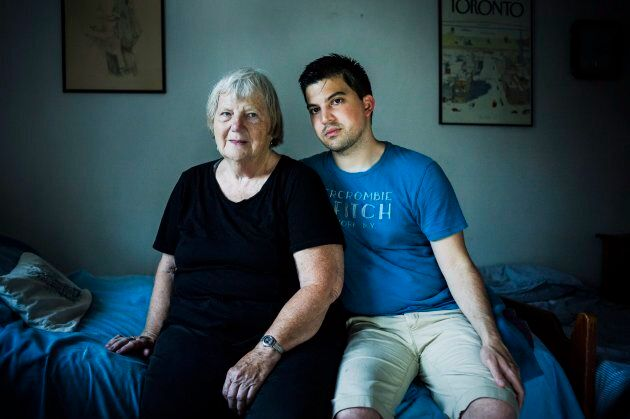 Elizabeth Hill poses for a portrait with her live-in student Julio Hernandez, in her home in Toronto, on July 20, 2018.