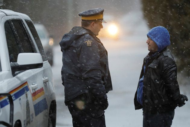 A man that claimed to be from Syria is detained by an RCMP officer after he crossed the U.S.-Canada border...