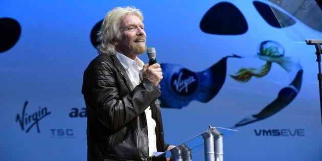 Virgin Group Founder Sir Richard Branson thanks Virgin Galactic workers during the unveiling ceremony...