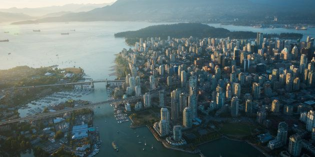 An aerial image of Vancouver, showing Stanley Park, downtown, Granville Bridge, Burrard Street Bridge...