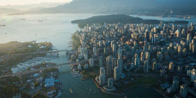 An aerial image of Vancouver, showing Stanley Park, downtown, Granville Bridge, Burrard Street Bridge...
