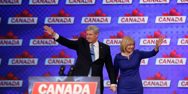 Stephen Harper and his wife Laureen waves to the crowd before he addresses supporters after he lost the...