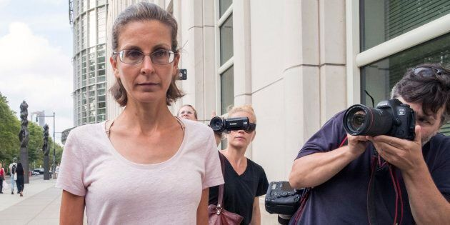 Clare Bronfman, left, leaves federal court, Tuesday, July 24, 2018, in Brooklyn, New York. Bronfman,...
