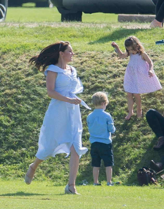 Catherine, Duchess of Cambridge, chasing after Prince George and Princess Charlotte during the Maserati Royal Charity Polo Trophy at Beaufort Park on June 10, 2018 (less than two months after giving birth to Prince Louis) in Gloucester, England.