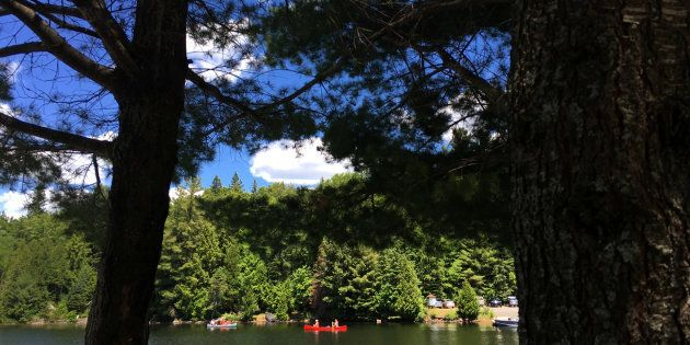 People paddle their canoe on Canoe Lake in Algonquin Park, July 4,