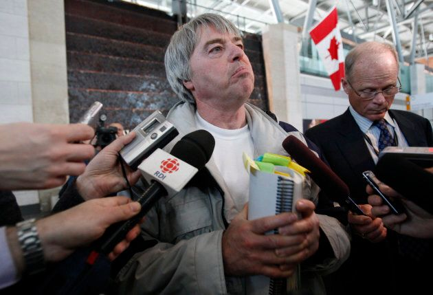 """Robert Latimer, who was granted day parole after serving seven years in prison for the 1993 """"mercy killing"""" of his severely handicapped daughter Tracy, speaks with journalists at the Ottawa International Airport in Ottawa on March 17, 2008."""