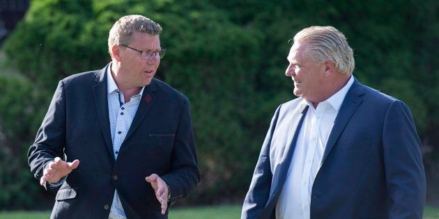 Saskatchewan Premier Scott Moe and Ontario Premier Doug Ford walk to a reception as the Canadian premiers...