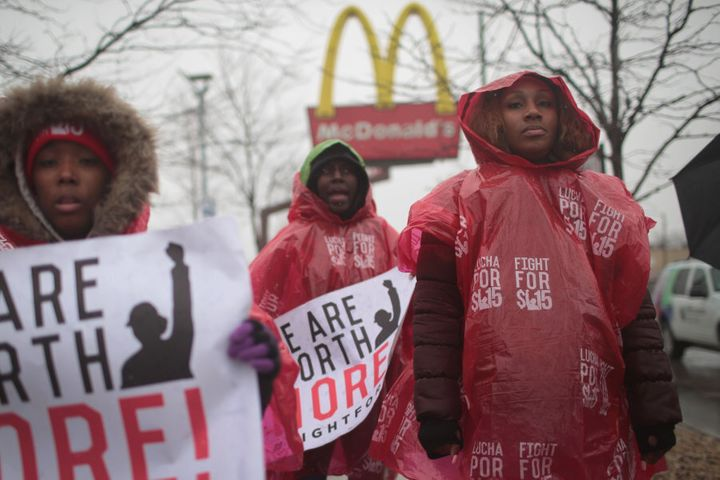 McDonald's workers protest outside of a company-owned restaurant on April 3, 2018 in Chicago, Ill. Employees at less desirable jobs, like those at fast food restaurants, would have more bargaining power with a basic income, the idea's proponents say.