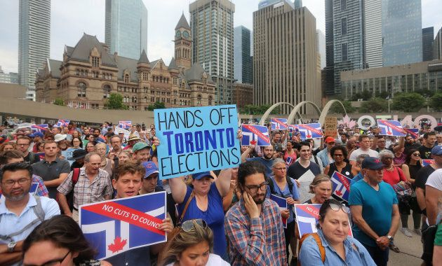 Hundreds gathered outside Toronto City Hall to protest Premier Ford's decision to slash the number of...