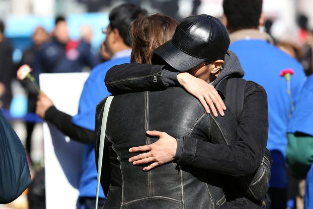 Two people hug at a makeshift memorial in Mel Lastman Square in Toronto for the victims of the van attack before a vigil on April 29, 2018.