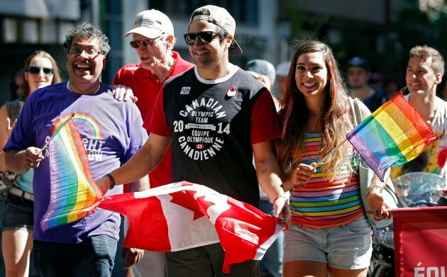 Calgary Mayor Naheed Nenshi , far left, marches with Olympians Samuel Edney, centre, and Shannon Rempel,...